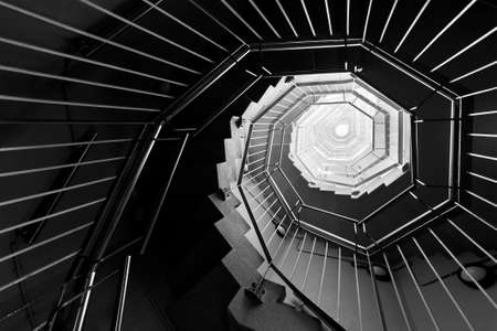 Spiral staircase. Modern Building abstract background Фото со стока