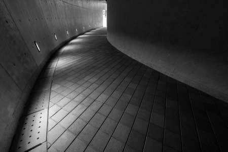 Empty modern pedestrian walkway in the dark
