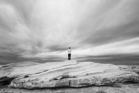 standing on rock. prospect concept. Фото со стока