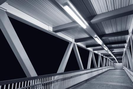 Empty modern foot bridge at night