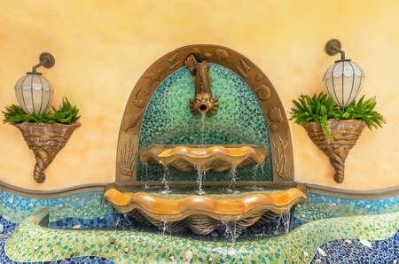 Classic fish fountain on wall