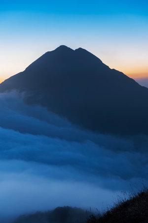 Mountain Fung Wong Shan - Lantau Peak at dusk. Natural landmark in hong kong Фото со стока