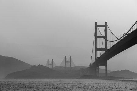 Silhouette of bridge in Hong Kong city Фото со стока