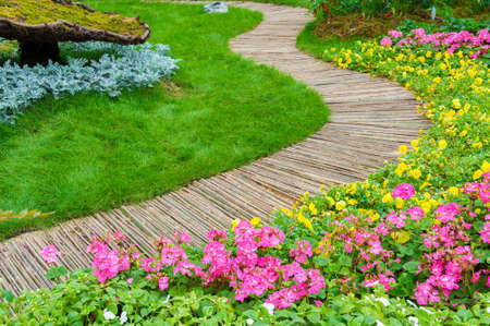 Green Path in ornate backyard flower Garden