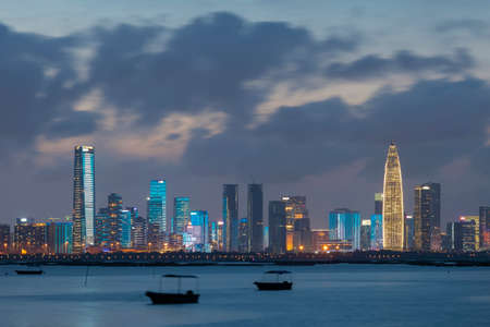 Skyline of Shenzhen city, China at night. Viewed from Hong Kong border Lau Fau Shan Фото со стока