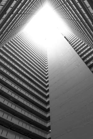 High rise residential building of public estate in Hong Kong city. Building abstract background 스톡 콘텐츠