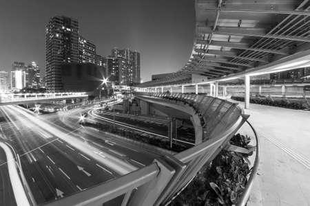 pedestrian walkway and traffic in Hong Kong city at night