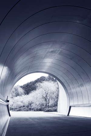 Exit of futuristic tunnel in monochrome