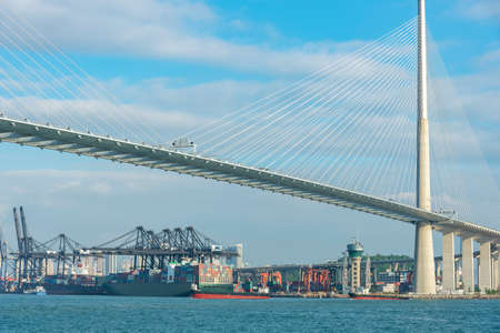 Container ship and bridge in cargo port of Hong Kong city