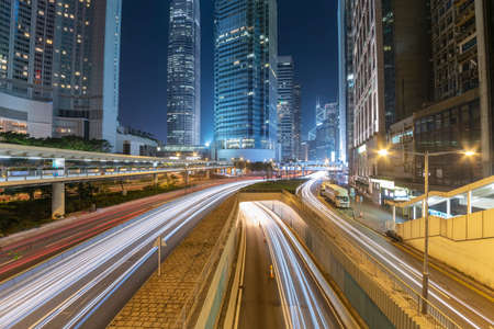 Traffic in downtown district of Hong Kong city at night 스톡 콘텐츠