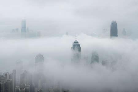 Skyline of Hong Kong city in fog 스톡 콘텐츠
