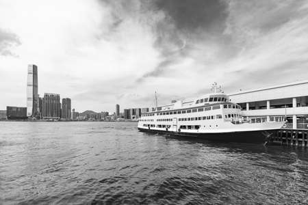 Ferry pier and skyline in Victoria harbor in Hong Kong city