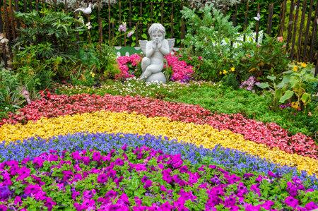 Sculpture of angel in ornamental garden 스톡 콘텐츠