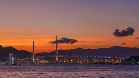 Panorama landscape of harbor and skyline of Hong Kong city under sunset 스톡 콘텐츠