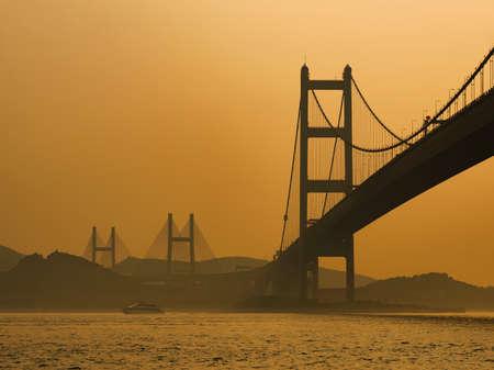 Silhouette of bridge in Hong Kong city 스톡 콘텐츠