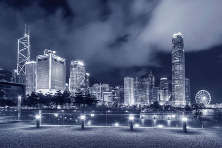 Night scenery of skyline and public park in downtown district of Hong Kong city