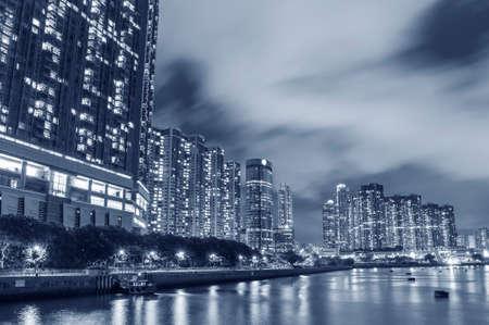 Seaside residential building in Hong Kong city at night