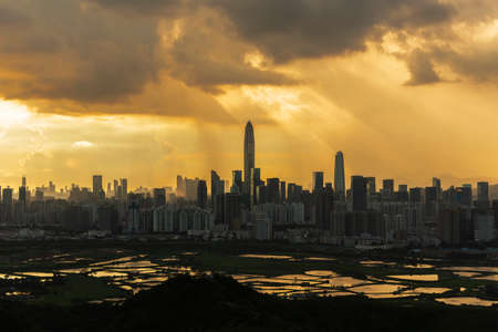 Silhouette of skyline of Shenzhen city, China under sunset. Viewed from Hong Kong border
