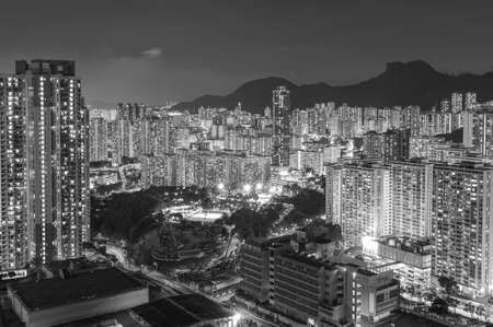 Lion Rock Hill and high rise residential building in Hong Kong city at night
