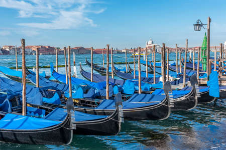 Gondola floating in the Grand Canal of Venice, Italy