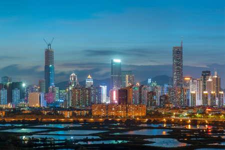 Night scenery of panorama of skyline of Shenzhen city, China. Viewed from Hong Kong border