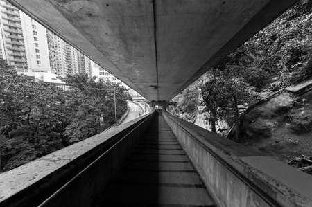 A empty old concrete pedestrian walkway in Hong Kong city