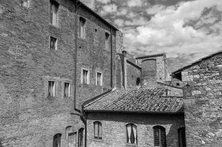 Exterior of old residential building in historical village San Gimignano, Tuscany, Italy