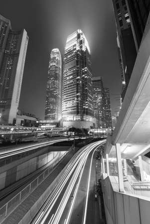 High rise modern office building in downtown of Hong Kong city at night Foto de archivo