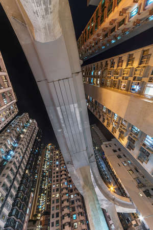 Elevated road through residential building in Hong Kong city