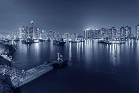 Night scenery of harbor and skyline of Hong Kong city