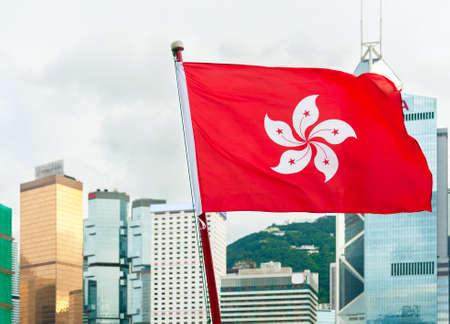 Hong Kong Flag with city skyline background Foto de archivo