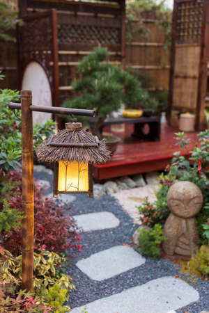 Lantern in beautiful oriental Japanese backyard garden