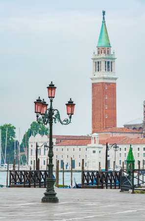 Street light and bell tower in historical city Venice, Italy Foto de archivo