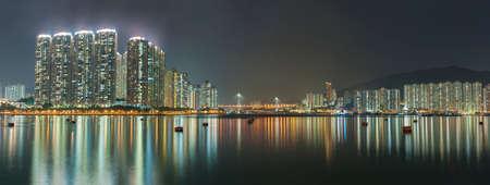 Panorama of harbor of Hong Kong city at night