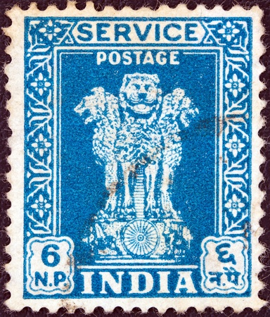 indian postal stamp: INDIA - CIRCA 1957  A stamp printed in India showing four Indian lions capital of Ashoka Pillar, circa 1957