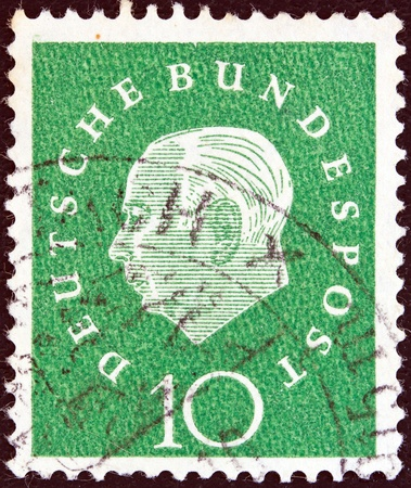 bundespost: GERMANY - CIRCA 1959  A stamp printed in Germany showing the first President of the Federal Republic of Germany Theodor Heuss, circa 1959