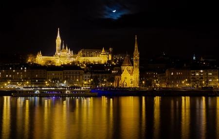 Fisherman s Bastion, St  Matthias church and Budai Reformatus night view, Budapest, Hungary  photo