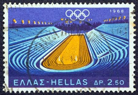 deportes olimpicos: GRECIA - CIRCA 1968 Un sello impreso en Grecia, desde los Juegos Olímpicos, tema de México, muestra Panathinaikon estadio que fue sede de los Juegos Olímpicos de primera moderna, alrededor del año 1968