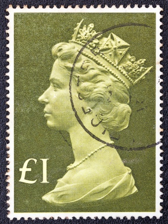 UNITED KINGDOM - CIRCA 1977  A postage stamp printed in United Kingdom showing a portrait of Queen Elizabeth II, circa 1977
