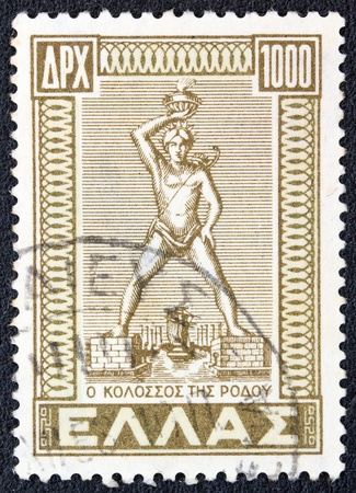 stempeln: GREECE - CIRCA 1947  A stamp printed in Greece from the   Dodecanese integration  issue shows Colossus of Rhodes, circa 1947