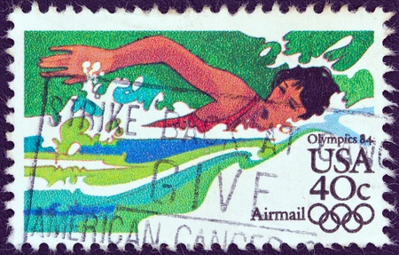 USA - CIRCA 1983  A stamp printed in USA from the  Summer Olympic Games, Los Angeles 1984  issue shows a swimming athlete, circa 1983   Stock Photo - 13591039