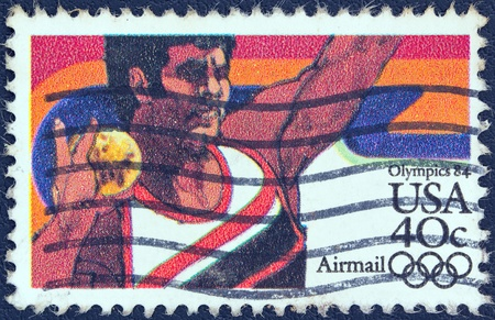 USA - CIRCA 1983  A stamp printed in USA from the  Summer Olympic Games, Los Angeles 1984  issue shows a shot putting athlete, circa 1983   Stock Photo - 13591040