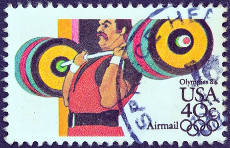 USA - CIRCA 1983  A stamp printed in USA from the  Summer Olympic Games, Los Angeles 1984  issue shows a weightlifter athlete, circa 1983   Stock Photo - 13591034