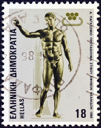 GREECE - CIRCA 1986  A stamp printed in Greece issued for the First World Junior Athletic Championships, Athens, shows  Antikythera Ephebe  ancient statue, circa 1986  photo