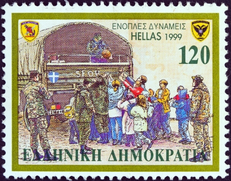 distributing: GREECE - CIRCA 1999: A stamp printed in Greece from the Armed Forces issue shows Forces distributing aid in Bosnia, circa 1999.  Editorial
