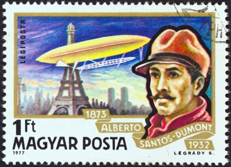 magyar: HUNGARY - CIRCA 1977: A stamp printed in Hungary from the Airships issue shows Alberto Santos-Dumont and airship Ballon No. 5 over Paris, circa 1977.  Editorial