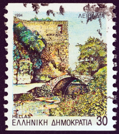 estampilla: GREECE - CIRCA 1994: A stamp printed in Greece from the Prefecture Capitals (4th series) issue shows bridge and tower, Livadeia, Boeotia, circa 1994.