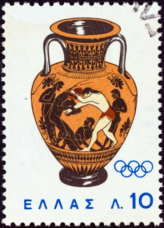 GREECE - CIRCA 1964: A stamp printed in Greece from the 'Olympic Games, Tokyo' issue shows Peleus wrestling with Atlanta (amphora) 500 B.C., circa 1964.