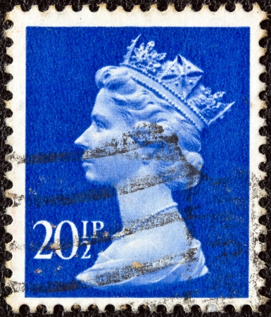 UNITED KINGDOM - CIRCA 1971: A stamp printed in United Kingdom shows a portrait of Queen Elizabeth II, circa 1971.