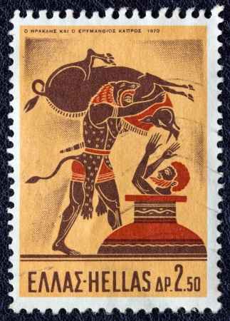 GREECE - CIRCA 1970: A stamp printed in Greece, from the Hercules issue shows Hercules capturing the Erymanthian Boar, circa 1970.